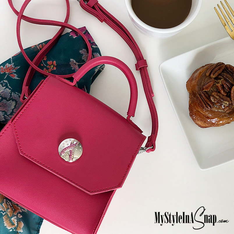 WEAR PINK! The Collector's Edition Fuchsia Grand Emily Bag is a small bag with big wow! The front holds any of our 30mm Grand snaps - the Grand Ribbon Snap Pinks shown is included. Shop MyStyleInASnap.com