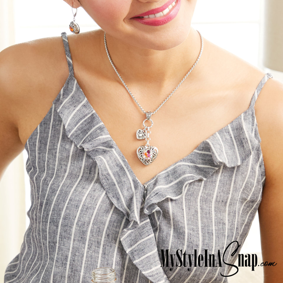 The large heart on the Mini Cascading Hearts Pendant holds your favorite mini 12mm jewelry snap you can swap in and out to match your outfit or your mood. Shop MyStyleInASnap.com LOVE IT? Join us and get it all at consultant prices.