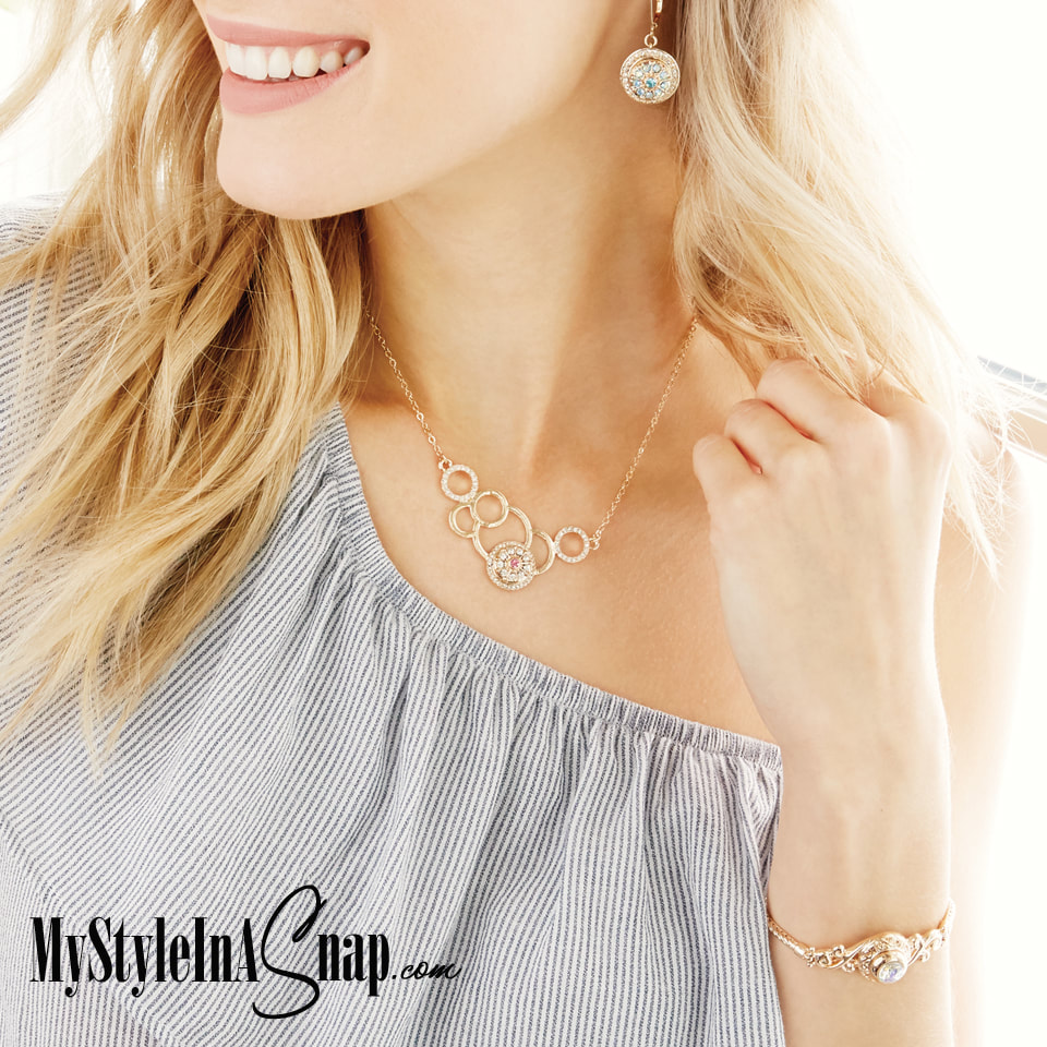 Discover the versatility of the Mini Yellow Gold Revolution Necklace that holds one 12mm jewelry Snap of your choice to coordinate with your outfit, your mood or your personality. Shop MyStyleInASnap.com LOVE IT? Join us and get it all at consultant prices.